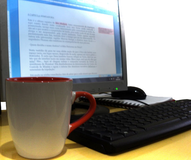 Public domain image of a computer and coffee cup